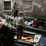 Venetian gondoliers, Italy